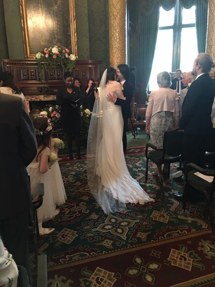 Bride Katie is wearing a bespoke 3-piece wedding outfit by Kate Edmondson, London